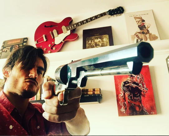 gun and guitar